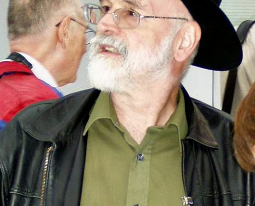 """Terry Pratchett 2005"". Licensed under CC BY-SA 3.0 via Wikimedia Commons - http://commons.wikimedia.org/wiki/File:Terry_Pratchett_2005.JPG#/media/File:Terry_Pratchett_2005.JPG"